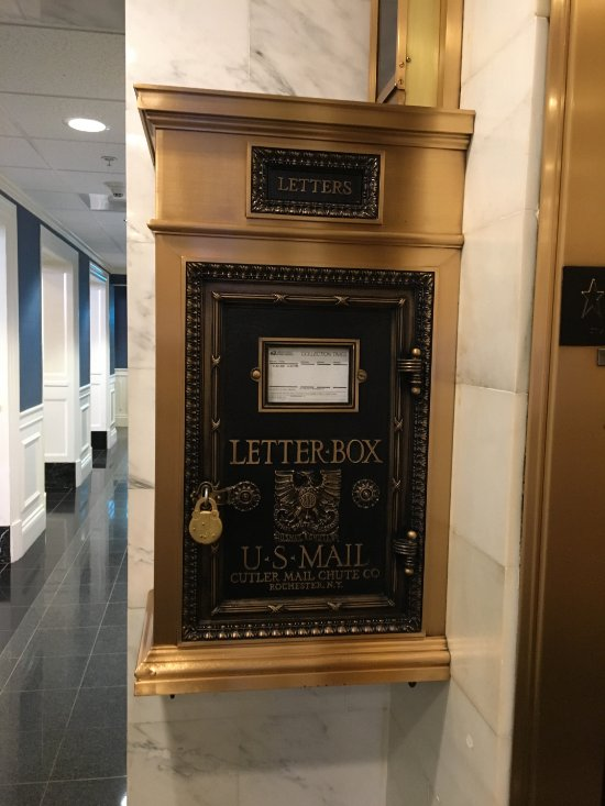 Historic letterbox inside the building.